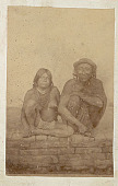 view Portrait of Man and Woman in Costume on Brick Wall digital asset: Portrait of Man and Woman in Costume on Brick Wall