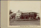 view Jamaican Men and Two Whites Outside Hotel, Horse And Buggy at Entrance; Grass Tennis Court ? in Foreground digital asset: Jamaican Men and Two Whites Outside Hotel, Horse And Buggy at Entrance; Grass Tennis Court ? in Foreground