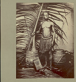 view Portrait of Male Laborer Wearing African Grass Skirt and With Paddle?, Wood Barrels, and Sanza (African Musical Instrument) 1887 digital asset number 1