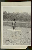 view Choco Man in Ceremonial Costume on Shore and Young Boy in River 1923 digital asset number 1