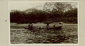 view Choco Man in Costume with Woman and Young Child in Dugout Canoe On River 1923 digital asset number 1