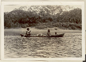 view Choco Man in Costume; Woman and Young Child in Dugout Canoe on River 1923 digital asset number 1