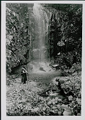 view Two Amahuaca Men, One with Bow and Arrow at Waterfall JUL 1910 digital asset number 1