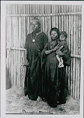 view Amahuaca? Man, Woman, and Young Girl Wearing Face Paint and in Costume Outside Bamboo House JUL 1910 digital asset number 1