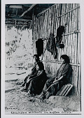 view Three Amahuaca Men in Costume Outside Bamboo House with Thatch Roof In Coffee Camp JUL 1910 digital asset number 1