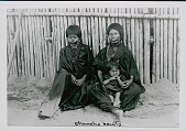 view Two Amahuaca Women and Young Girl Wearing Face Paint and in Costume Outside Bamboo House JUL 1910 digital asset number 1
