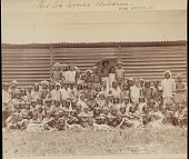 view Assamese children outside wood-slat building with canopied roof, probably a tea house, undated digital asset number 1
