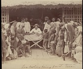 view Assamese tea receiving payment from man at a table, undated digital asset number 1