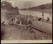 view Assamese men loading tea onto bamboo boats, undated digital asset number 1