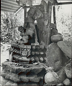 view Ancient Statue of Hindu Goddess Durga with Offerings of Leaves, Coins, Pottery, Etc Made by Local Villagers 1954 digital asset number 1