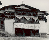 view Stone and Wood Gompa (Sacred Library) with Curtain Over Entrance Portraying Eight Auspicious Emblems of Buddhism 1954 digital asset number 1