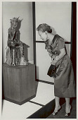view Madame Yang, Wife of Korean Ambassador, Viewing Bronze Maitreya of Old Silla Dynasty at Exhibit of Korean Art in National Gallery of Art 1957 digital asset number 1