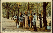 view Group of Latex Collectors in Costume and with Buckets; Man Extracting Latex from Tree on Rubber Plantation n.d digital asset number 1
