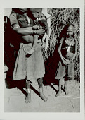 view Two Young Girls and Infant in Costume and with Ornaments Near Brush Structure 1965 digital asset number 1