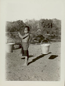 view Girl in Costume, Carrying Yoke with Two Metal Buckets Near Stream digital asset: Girl in Costume, Carrying Yoke with Two Metal Buckets Near Stream