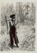 view Man in Costume and Carrying Wood Axe with Metal? Head 1931 digital asset number 1