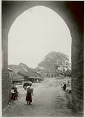view Khun Woman in Costume and Carrying Baskets with Yoke at Brick Archway to Shan Village; Plank and Shingled Houses, Brick Structure and Group in Costume in Village Street digital asset: Khun Woman in Costume and Carrying Baskets with Yoke at Brick Archway to Shan Village; Plank and Shingled Houses, Brick Structure and Group in Costume in Village Street