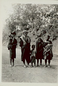 view Family Group in Costume; Woman Carrying Cloth Bag on Head On Road 1931 digital asset number 1
