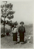 view Two Young Women in Costume and with Ornaments on Hilltop Above Village 1931 digital asset number 1