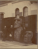 view George Brown Goode, Samuel D. Langley, and Otis T. Mason with Two Moai (Lava Stone Effigy Figures) Inside Museum Building digital asset: George Brown Goode, Samuel D. Langley, and Otis T. Mason with Two Moai (Lava Stone Effigy Figures) Inside Museum Building