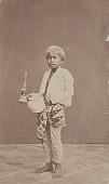 view Portrait of Boy in House Servant Costume, Holding Kerosene Lamp and Ceramic Jug n.d digital asset number 1