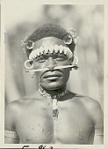 view Portrait of Man with Scarification and Wearing Shell, Bead, And Flower Ornaments digital asset: Portrait of Man with Scarification and Wearing Shell, Bead, And Flower Ornaments