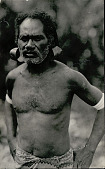 view Man with Scarification, in Costume and Wearing Large Metal Ear Ornaments digital asset: Man with Scarification, in Costume and Wearing Large Metal Ear Ornaments