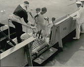 view Group of Children Boarding Ship with Help of Man Dressed As Santa Claus;                   Officer in Uniform Nearby digital asset: Group of Children Boarding Ship with Help of Man Dressed As Santa Claus;                       Officer in Uniform Nearby