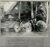 view Two Men Wearing Breechcloths Near Three Coral Money Discs Outside Pole Thatch Village Council House on Ceremonial Stone Platform 1893 digital asset number 1