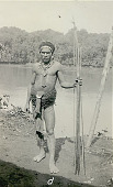 view New Guinea Man Wearing Rattan? Fiber Breech-Cloth Ornaments and Holding Spears Near Water 1891 digital asset number 1