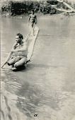 view Two New Guinea Men in Costume; Papuan Canoe on River digital asset: Two New Guinea Men in Costume; Papuan Canoe on River