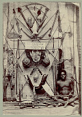 view Man Wearing Breechcloth and Holding Club Near Display of New Caledonian Tools and Weapons digital asset: Man Wearing Breechcloth and Holding Club Near Display of New Caledonian Tools and Weapons