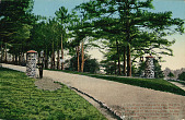 view Entrance Road to U S Army Camp with Man in Uniform Near Masonry Markers n.d digital asset number 1