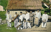 view Group in Costume and with Musical Instruments Outside Woven Mat House with Thatch Roof digital asset: Group in Costume and with Musical Instruments Outside Woven Mat House with Thatch Roof