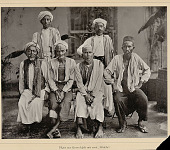 view Portrait of Six Men in Costume and with Turbans and Fezzes Outside Masonry Building n.d digital asset number 1