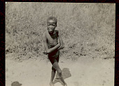 view Young Boy Wearing Breechcloth (Photo Taken from Train) 06 FEB 1925 digital asset number 1