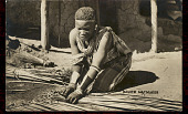 view Lesotho Woman Making Reed Mat Outside Stucco, Mud and Wood House n.d digital asset number 1