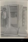 view Man Near Geometrically Decorated Entranceway to Kraal (Stockaded Village); View of Doorway of Geometrically Decorated House with Thatch Roof Beyond n.d digital asset number 1