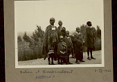 view Group of Women and Children in Costume and Wearing Blankets On Roadway at Train Station 11 MAR 1922 digital asset number 1