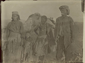 view Aged Woman in Costume, Aged Man, Young Woman and Children Outside Brush Structure in Desert 1899 digital asset number 1