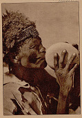 view Aged Bushman Costume, Drinking Water from Ostrich Eggshell Container SEP 1936 digital asset number 1