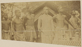 view Belgian Congo Men in Costume, Including Cook and Servants Of Photographer, Outside Tents of Camp n.d digital asset number 1