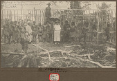 view Rev Ellen I. Burke, Non-Native Woman, Under Umbrella, and Group of Workers in Costume Near Wood Frame of Rest House Under Construction NOV 1924 digital asset number 1