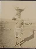 view Woman in Costume with Basket of Goods on Head Near Structure n.d digital asset number 1