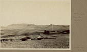 view View of Mount Insizwa from South Village of Round Mud Houses with Thatch Roofs, Stone Fence, and Cultivated Fields 21 MAR 1922 digital asset number 1