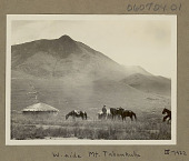 view View of Mount Tabankulu, West Side, and Round Mud Houses With Thatch Roofs; Non-Native Man and Guide? with Pack Saddled Horses Nearby MAR 1922 digital asset number 1