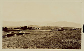 view View of Village Showing Round Mud Houses with Thatch Roofs; Mountains in Distance n.d digital asset number 1
