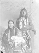 view Little Dog and His Wife Holding Child, All in Native Dress with Ornaments n.d digital asset number 1
