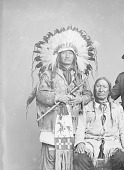 view Red Hawk (left) in Native Dress with Headdress and Holding Pipe and Bag, American Horse (right) in Native Dress Nearby n.d digital asset number 1