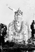 view American Indian Man in Native Dress with Bear Claw Necklace and Abraham Lincoln? Peace Medal and Ornaments n.d digital asset number 1